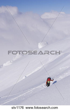 Stock Images of A woman ski mountaineering on Mount Vsevidov in.