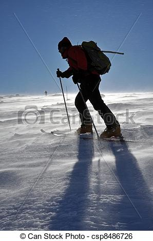 Stock Image of Back country skier (ski touring), walking up to a.
