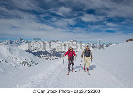 Stock Photography of Two elderly men practice ski mountaineering.