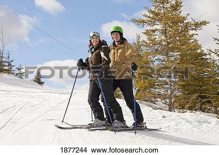 Stock Photo of red deer, alberta, canada; a couple on a ski hill.