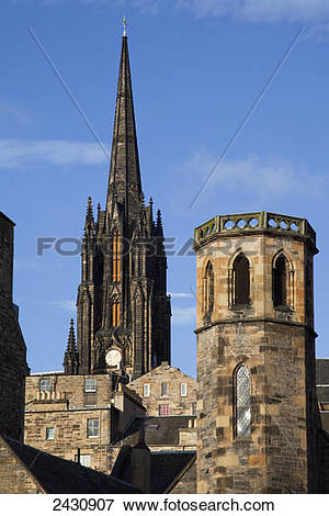 Picture of Clock tower of a cathedral and rooftops of various.