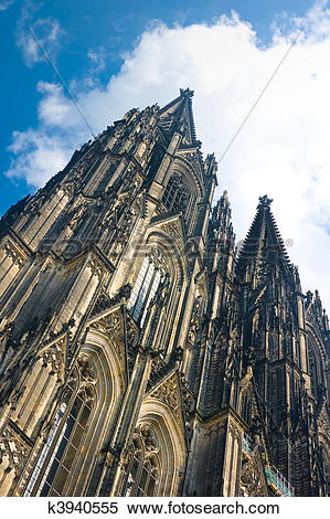 Stock Image of Towers of Koelner Dom Cologne Cathedral over blue.