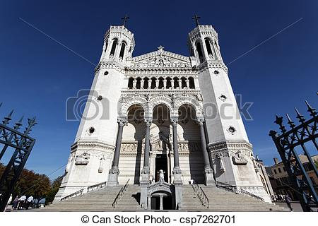Stock Photography of front of lyon Cathedral and blue sky.