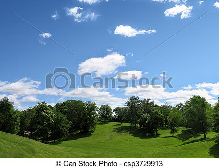 Stock Photos of Beautiful cloudy filled sky over rolling hills and.