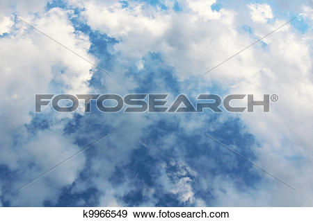 Stock Photograph of Dramatic Cloud Filled Blue Sky k9966549.