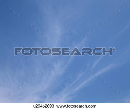 Stock Photo of Blue sky filled with cirrus clouds, Maldives.