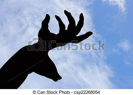 Stock Images of deer and horn shape hand silhouette in blue sky.