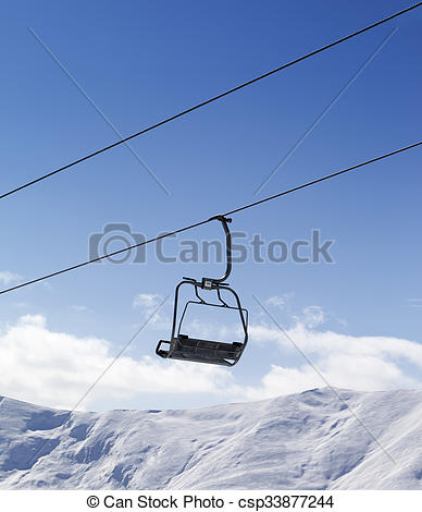 Stock Photo of Chair lift against blue sky. Caucasus Mountains.