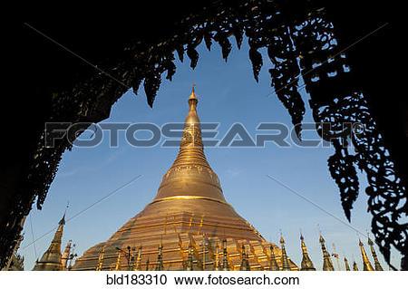 Stock Photography of Ornate temple under blue sky, Yangon, Yangon.