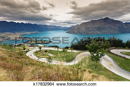 Stock Photo of Luge track with beautiful lake and mountain at.