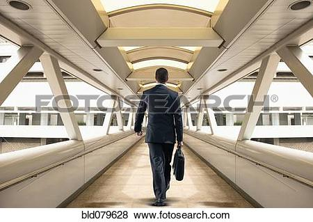 Pictures of Asian businessman walking over skywalk bld079628.