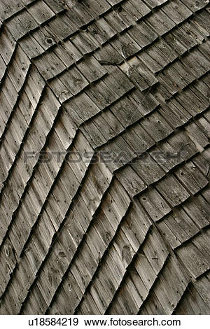 Stock Photograph of pitched, roof, exterior, shingles, tiles.