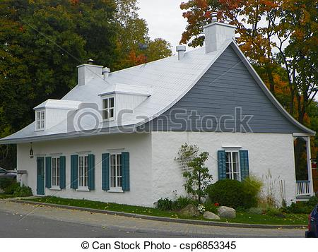 Stock Images of Quaint sloped roof home in Quebec.