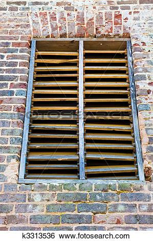Stock Images of Old Wood Slat Window on Brick Wall k3313536.