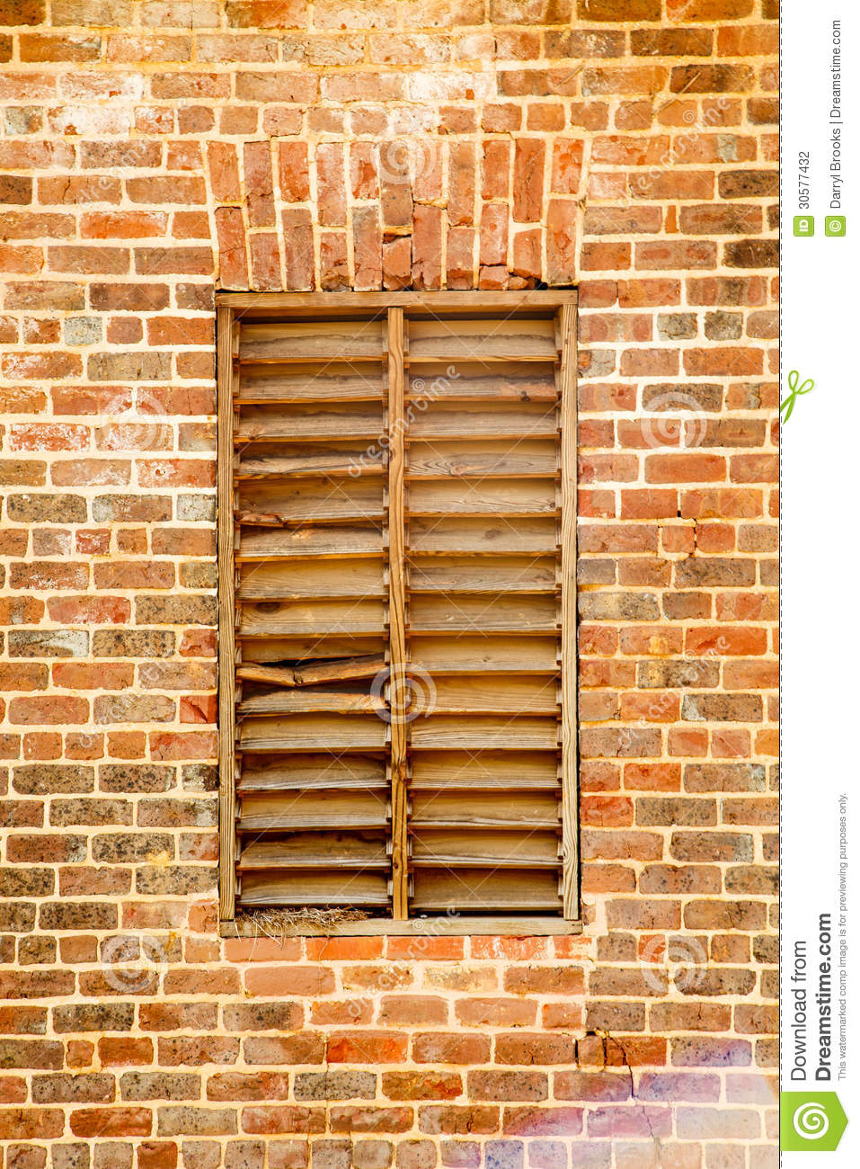 Old Wood Slat Window In Brick Wall Stock Photography.