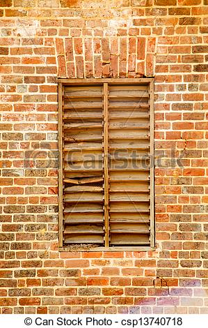 Stock Photography of Old Wood Slat Window in Brick Wall.