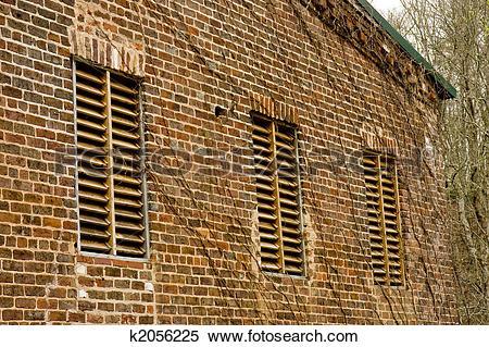 Stock Image of Wood Slat Windows in Old Brick Mill k2056225.