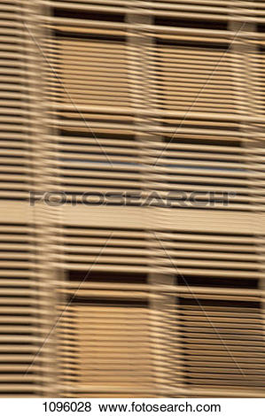 Pictures of Louvered wooden slats in front of window 1096028.