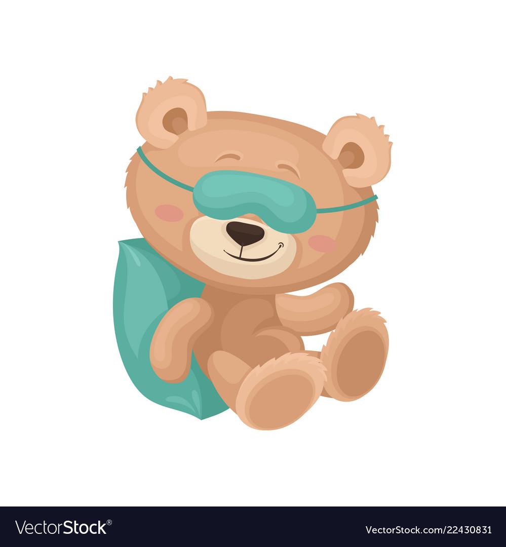 Cute teddy bear in sleeping mask dreaming on.
