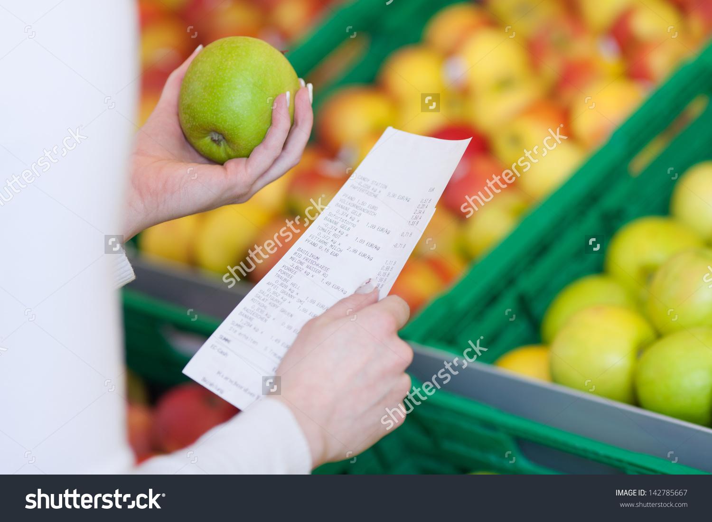 Woman Checking Her Till Slip Or Receipt When Shopping For Fresh.