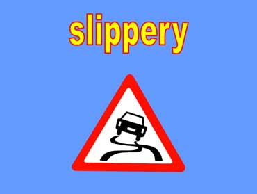 Road Sign For Slippery Road.
