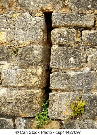 Stock Photographs of Arrow slit in medieval wall.