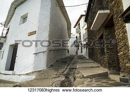 Stock Images of A sloped street between houses in Pampaneira, one.