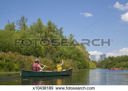 Stock Photograph of Family Kayaking in Bellevue Mercer Slough.