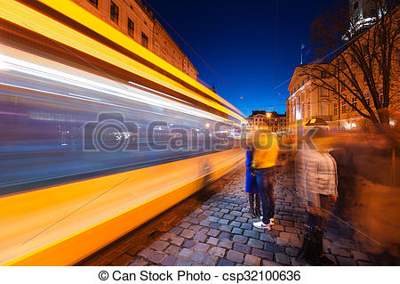 Stock Photos of Night Scene of a moving tram in Lviv. Slow shutter.