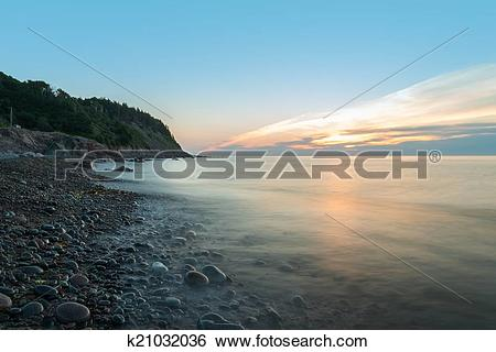 Stock Images of Ocean shore at a crack of dawn (Slow shutter speed.
