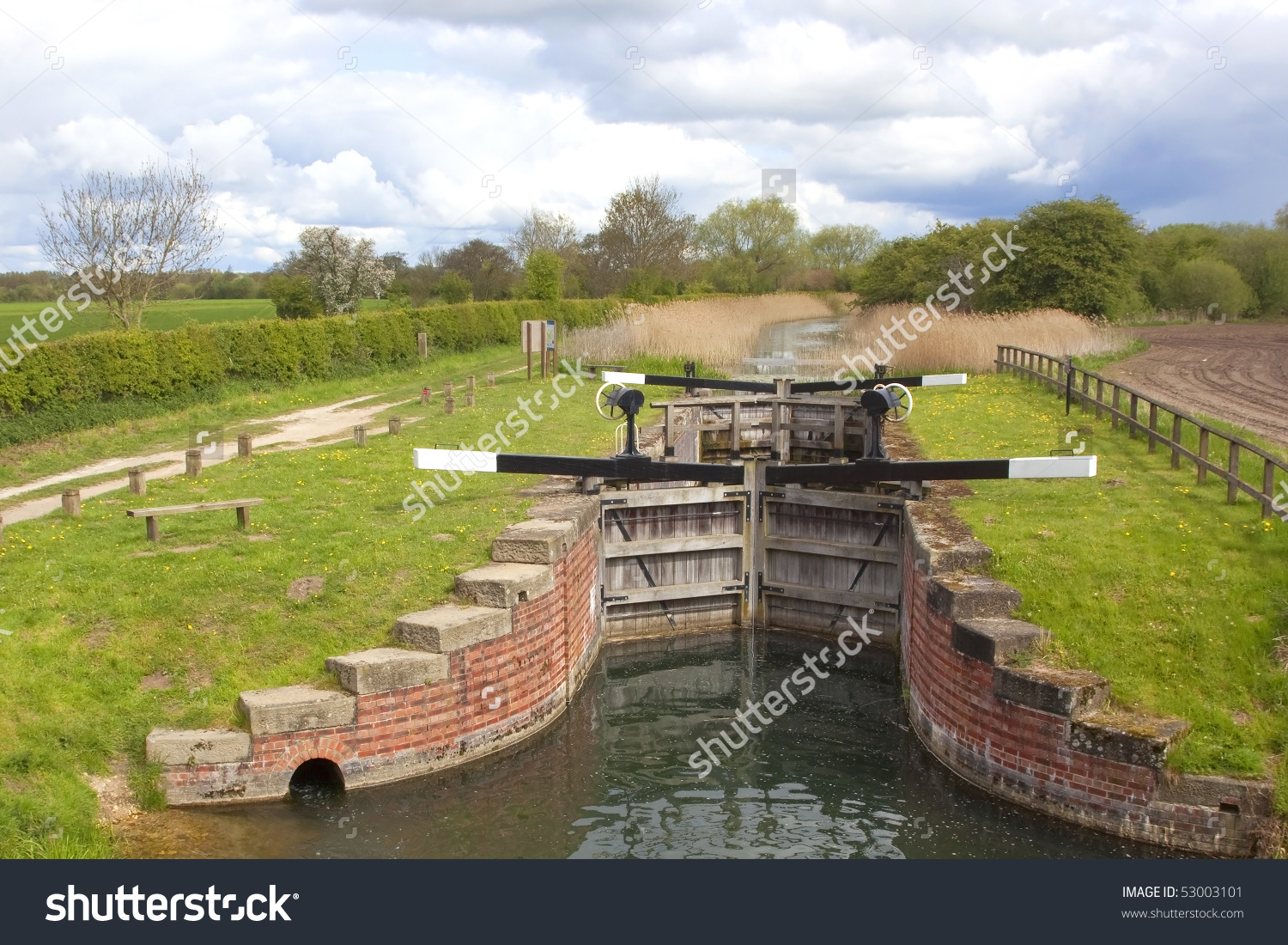 Traditional Wooden Sluice Gates Controlling Land Stock Photo.