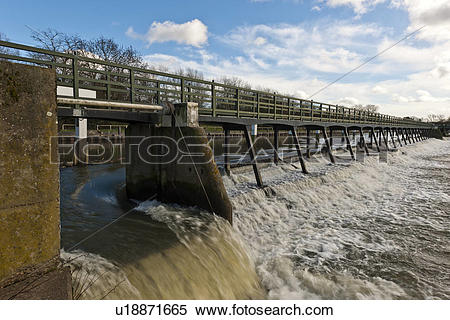 Stock Image of England, London, Teddington. Sluice gate in the.