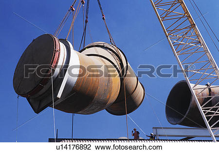 Stock Photo of Installing fume extraction pipe into steel foundry.