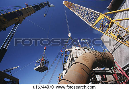 Stock Photography of Installing fume extraction pipe into steel.
