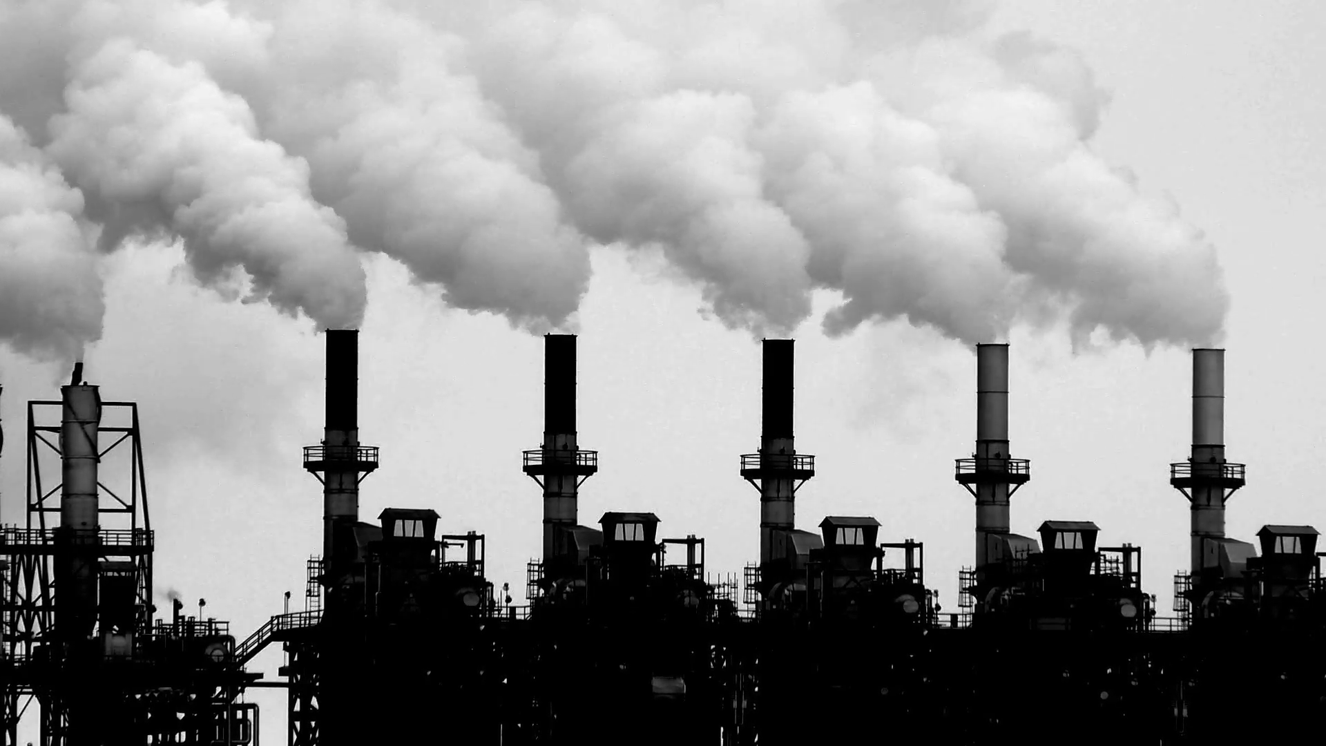 Smoke stacks of an oil processing plant, Alberta, Canada Stock Video  Footage.