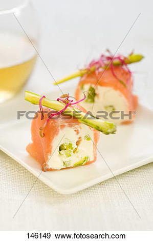Stock Photograph of Smoked salmon rolls filled with cream cheese.