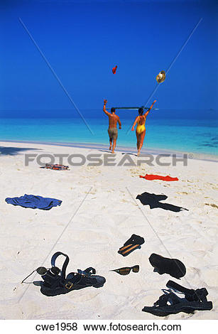 Pictures of Couple running to sea leaving trail of clothing across.