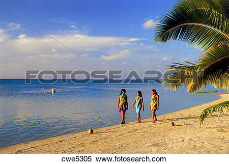 Stock Image of Three Polynesian girls walking along sandy shore on.