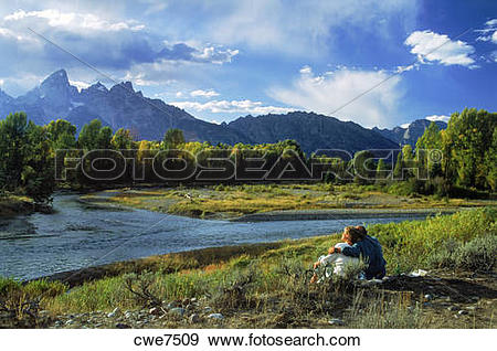 Stock Photograph of Couple on holiday in mountain paradise along.