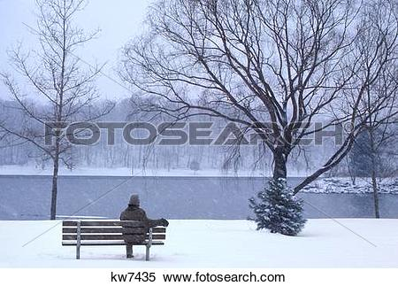 Stock Image of Single Anonymous Silhouetted Man Sitting Alone On.