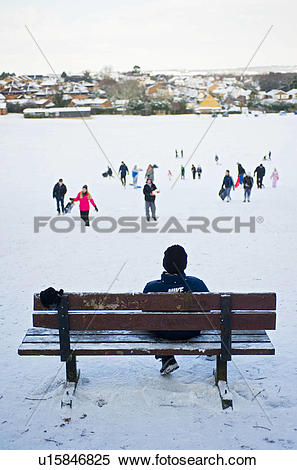 Stock Image of England, Essex, Basildon. A young boy sitting on a.