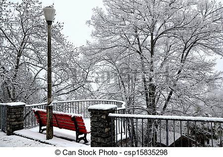 Stock Photographs of Bench and street lamp in the snow.