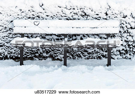 Stock Photograph of Heart shaped pattern on snow covered park.