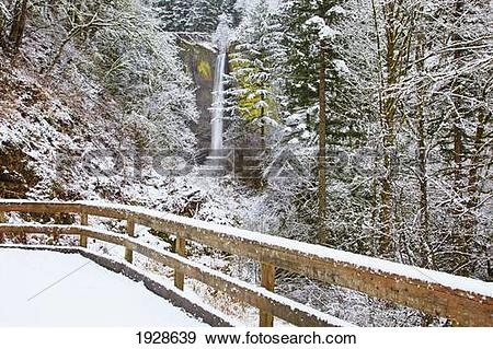 Stock Photograph of snow adds beauty to latourell falls, columbia.