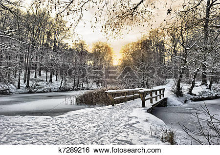 Stock Images of Wooden bridge under snow k7289216.