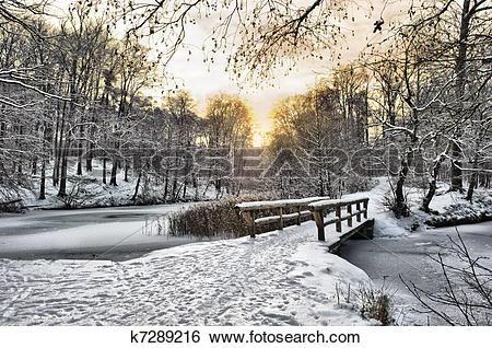 Stock Images of Wooden bridge under snow k7289216.