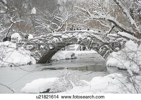 Stock Photo of Bridge over lake covered with snow, side view.