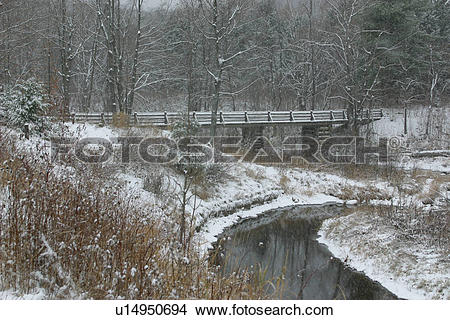 Stock Photo of Snowy winter landscape, with bridge, river and.