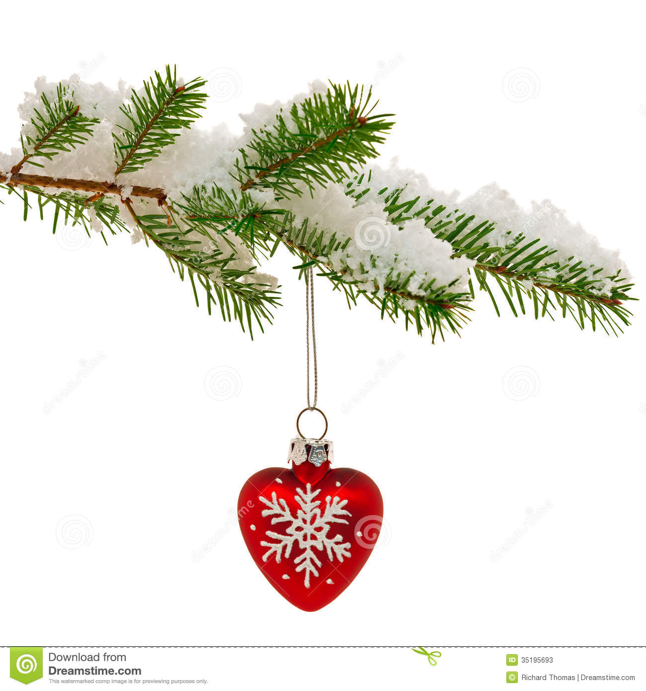 Christmas Bauble On Snow Covered Tree Branch. Stock Photos.