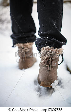 Picture of Girl walking on the snow with boots in the afternoon.
